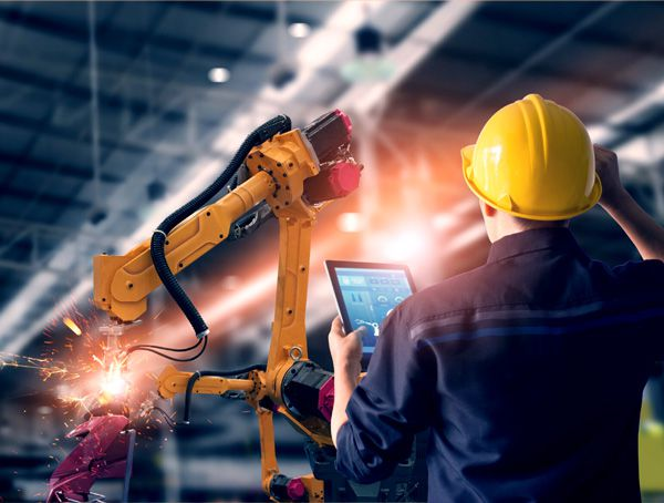 IFAM Slovenia Ljubljana Worker with Robots